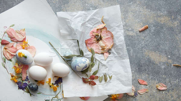 Creative Easter composition with dry flowers and eggs Stock photo © artjazz