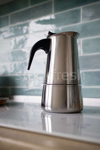 stainless geyser coffee maker on a background of blue tiles Stock photo © artjazz