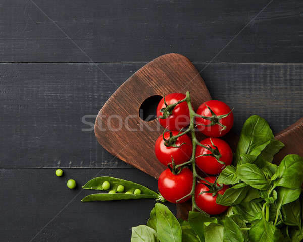 juicy bright summer vegetable on a dark wooden background, flat lay Stock photo © artjazz