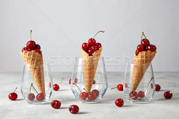Freshly picked ripe cherries in a sweet wafer cones standing in  Stock photo © artjazz