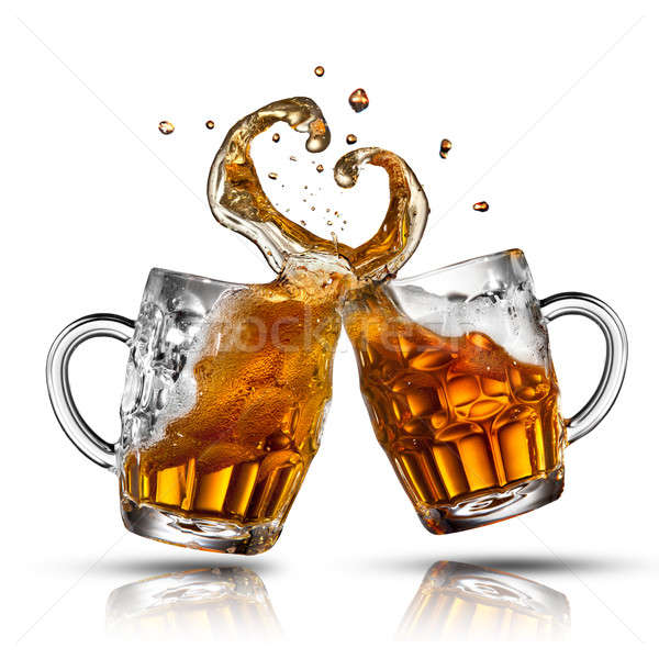 Stock photo: Beer splash in shape of heart isolated on white