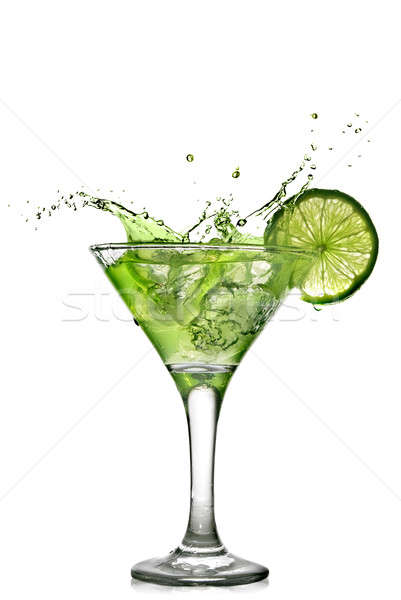 Green alcohol cocktail with splash and green lime isolated on white Stock photo © artjazz