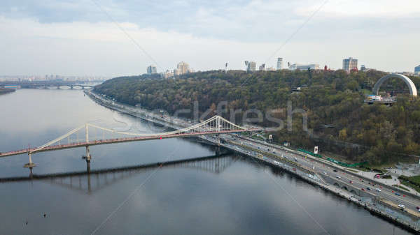 Aerial view of Bridge pedestrian across the Dnieper River, Embankment with traffic and the People's  Stock photo © artjazz