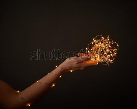 Рождества фары гирлянда женщины рук женщину Сток-фото © artjazz