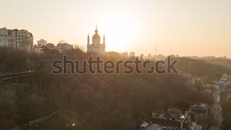 Sunset over Saint Andrew's church in Kyiv, Ukraine. Stock photo © artjazz