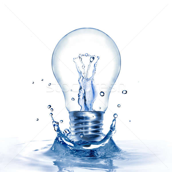 Energy concept. Light bulb with water and splash isolated on white Stock photo © artjazz