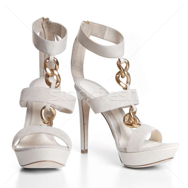 White leather female shoes on high heels isolated on white Stock photo © artjazz