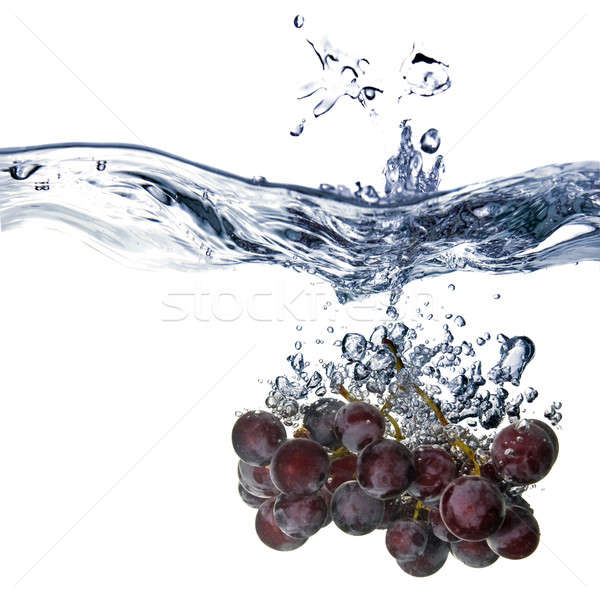blue grape dropped into water with splash isolated on white Stock photo © artjazz