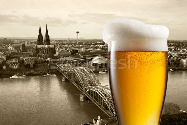 Glass of beer with view of Koeln on background Stock photo © artjazz