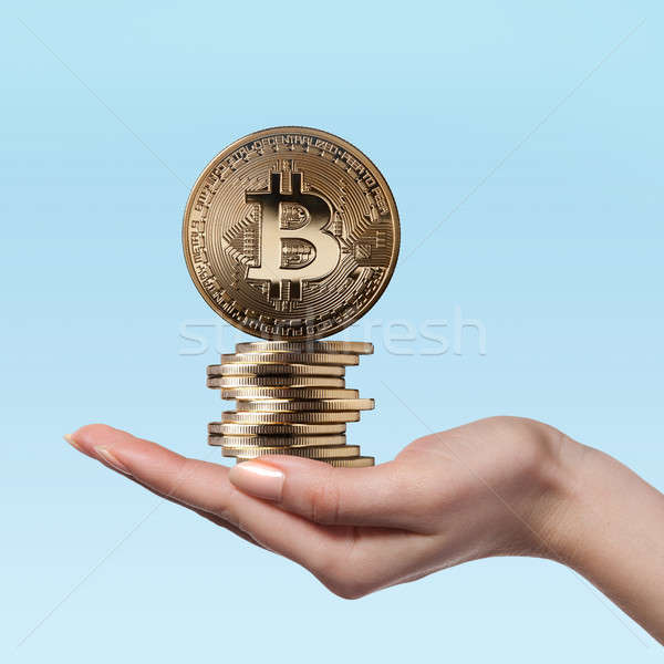 Female hand holds gold coins bitcoin Stock photo © artjazz