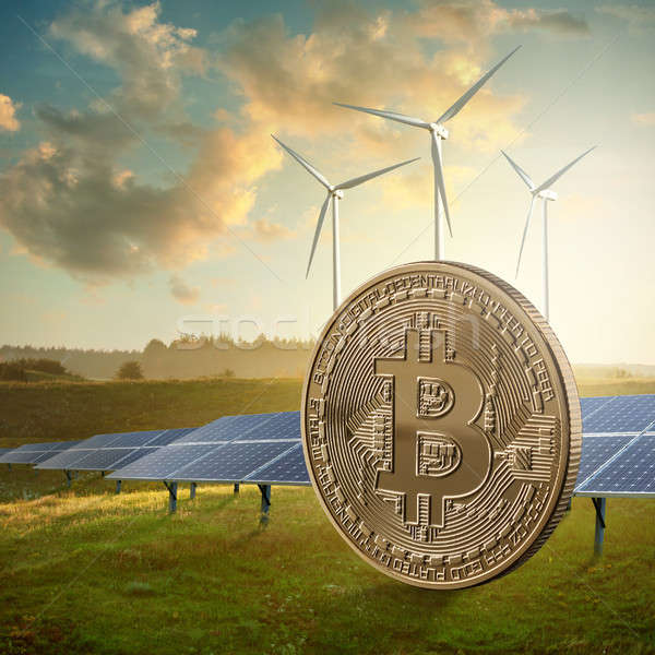 Gold coin bitcoin on a green field against the sky and solar panels. Eco mining concept Stock photo © artjazz