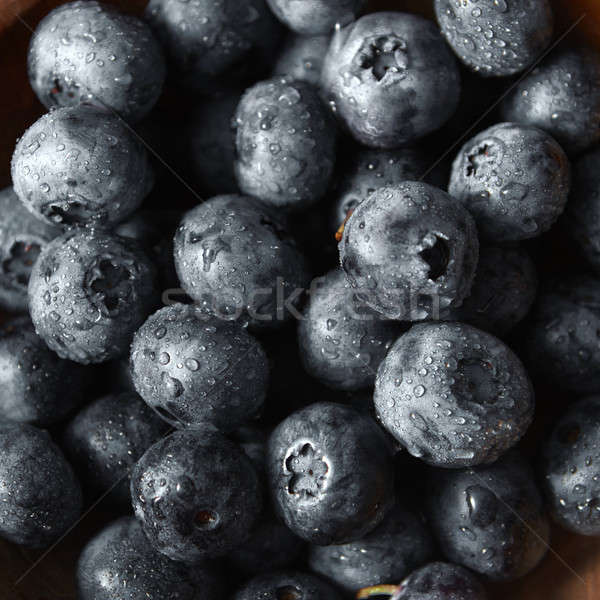 Close-up ripe sweet blueberries in water droplets with soft focus. Blueberries background. Stock photo © artjazz