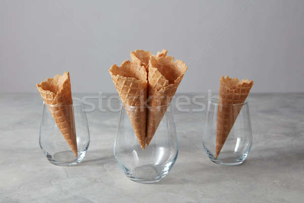 Sweet wafer cones for dessert empty in a glasses on a light gray Stock photo © artjazz