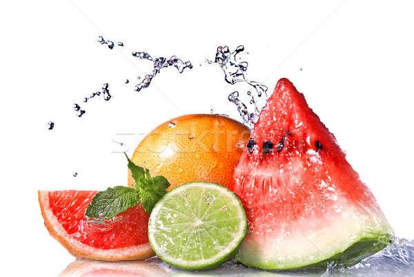 Water splash on  fresh fruits isolated on white Stock photo © artjazz
