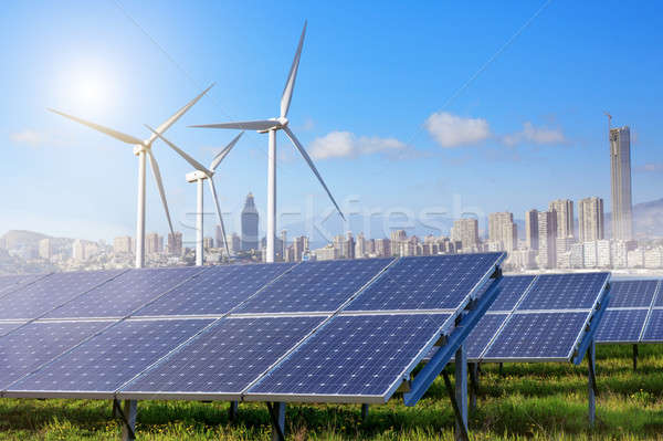 Solar panels and wind turbines with city Stock photo © artjazz