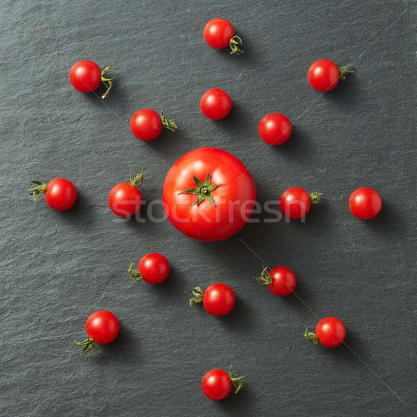cherry tomatoes in the form of the sun Stock photo © artjazz