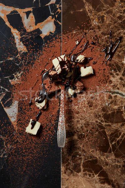 Cucchiaio cioccolato sciroppo di cioccolato buio marmo abstract Foto d'archivio © artjazz