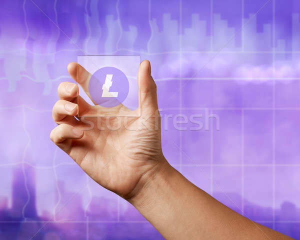 On a glass digital screen, the lithcoin icon on an ultraviolet background Stock photo © artjazz