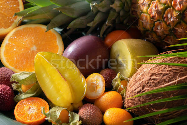 Fresh exotic organic fruits close up as natur background Stock photo © artjazz