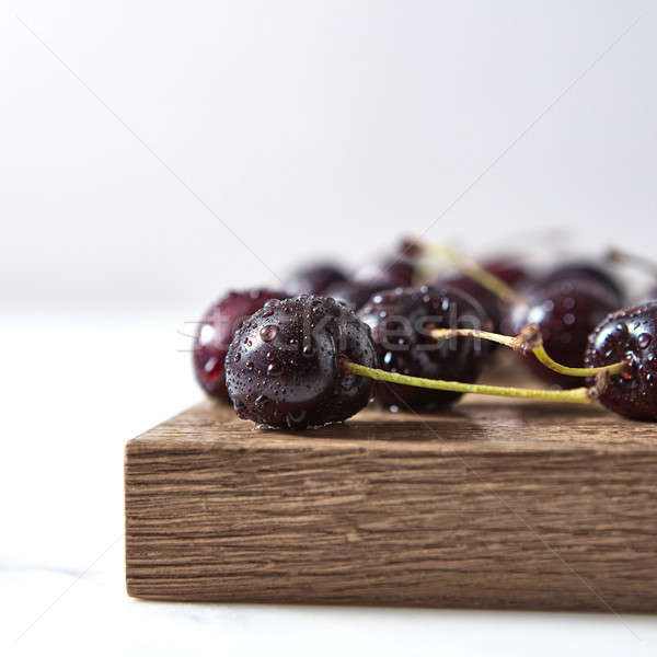 Home grown fresh cherry with shallow depth of field. Ingredients for sweet homemade jam on a board. Stock photo © artjazz