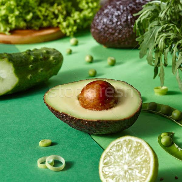 Friss organikus zöld zöldségek fél avokádó Stock fotó © artjazz