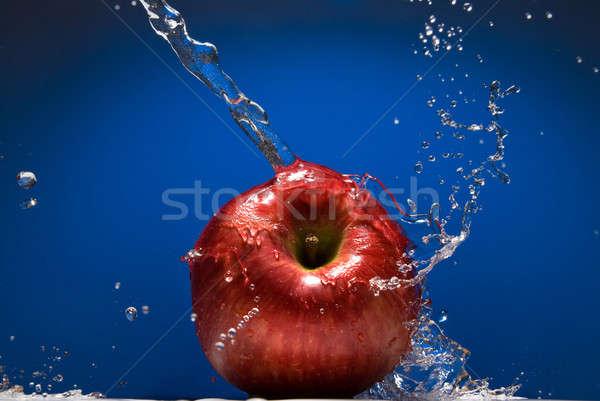 Piros alma csobbanás kék víz nyár hullám Stock fotó © artjazz