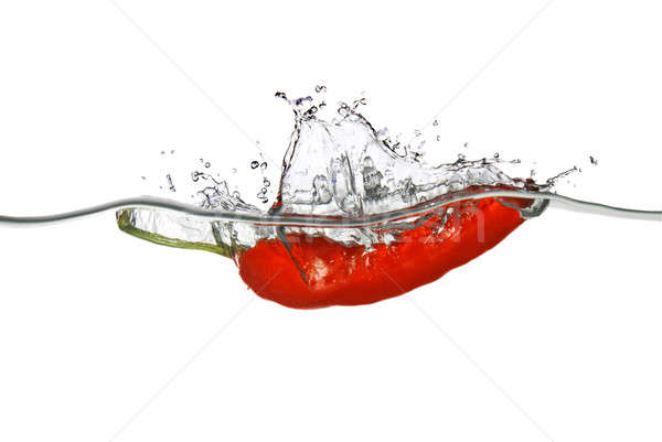 red pepper dropped into water with splash isolated on white Stock photo © artjazz