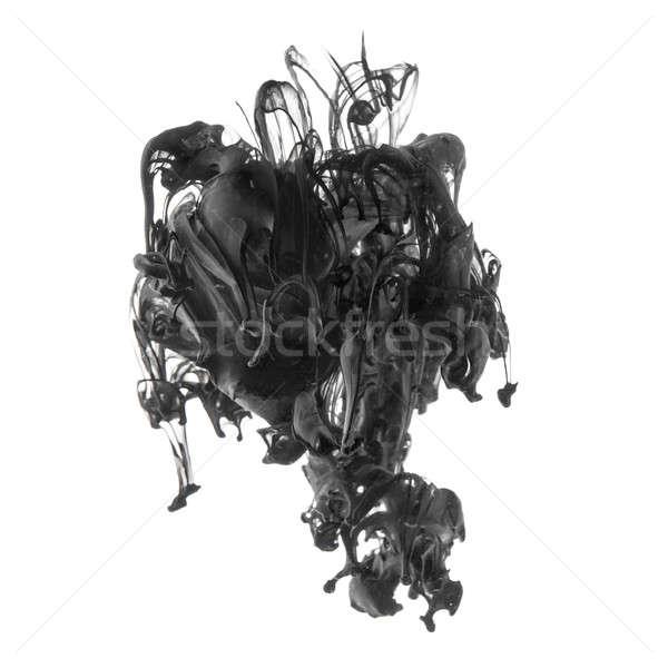 Splash of black ink in dropped into the water on white Stock photo © artjazz