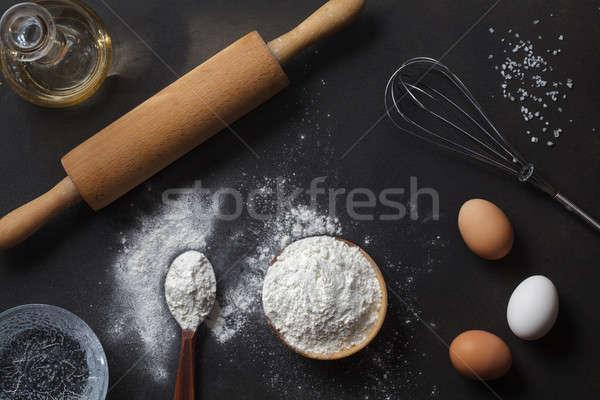 Farine ingrédients noir table haut vue Photo stock © artjazz