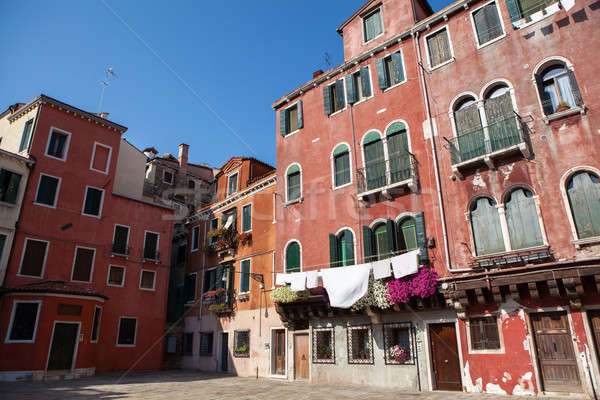 Laundry hanging out of a typical Venetian facade Stock photo © artjazz