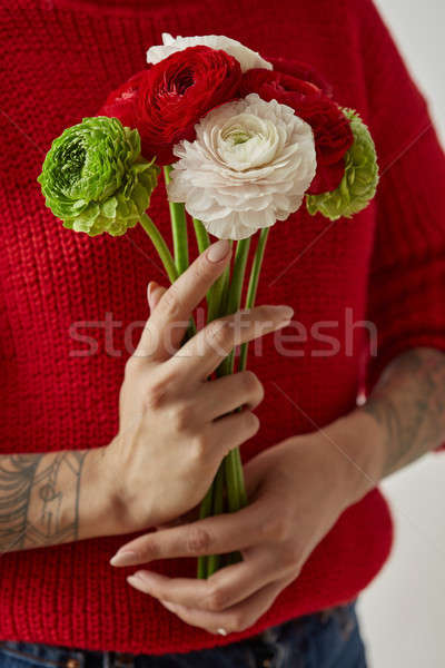 girl with a tattoo on her hands holding a bouquet of flowers Stock photo © artjazz
