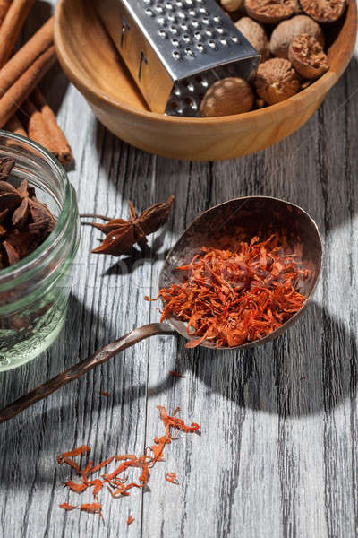 saffron with various spices on wooden background Stock photo © artjazz