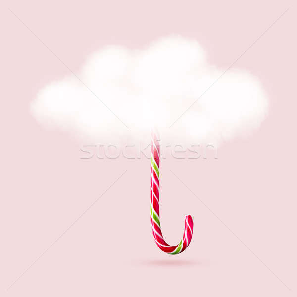 umbrella of clouds and long Christmas candy Stock photo © artjazz