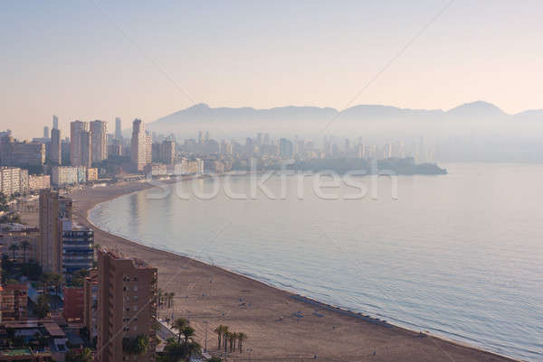 Benidorm covered with fog. Stock photo © artjazz