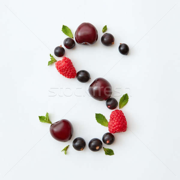 Flat lay pattern of letter S english alphabet from natural ripe berries - black currant, cherries, r Stock photo © artjazz