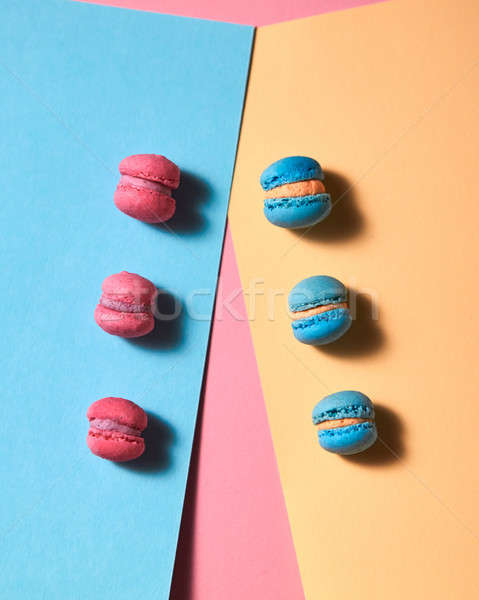 Pattern from different macaroons on a multicolored paper background Stock photo © artjazz