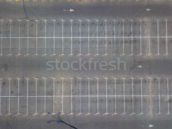 Empty parking place near the market with white marking lines on asphalt. Stock photo © artjazz