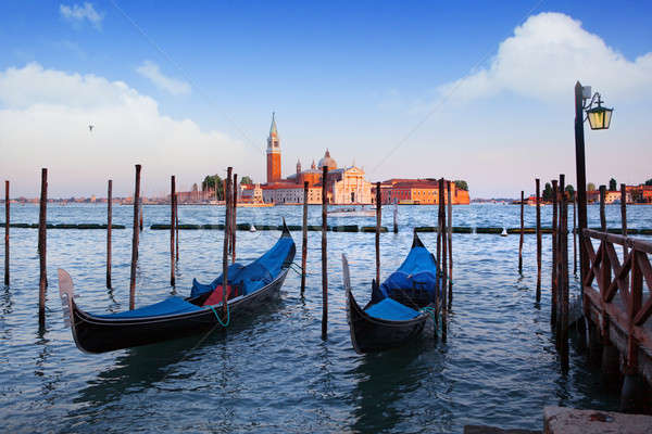 Gondolas and San Giorgio Maggiore church on Grand Canal in Venic Stock photo © artjazz