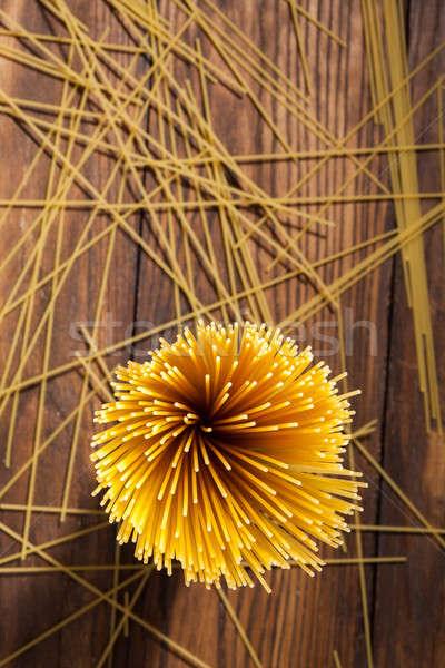 italian spaghetti on wooden background Stock photo © artjazz