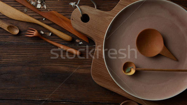 Cooking utensils on wooden table Stock photo © artjazz