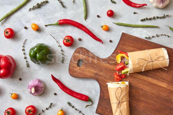 Halves of vegetable burrito on a wooden board Stock photo © artjazz