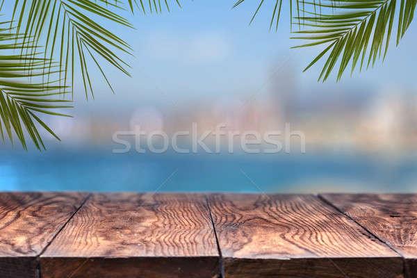 Fa asztal fából készült felfelé pálmafák homályos város Stock fotó © artjazz