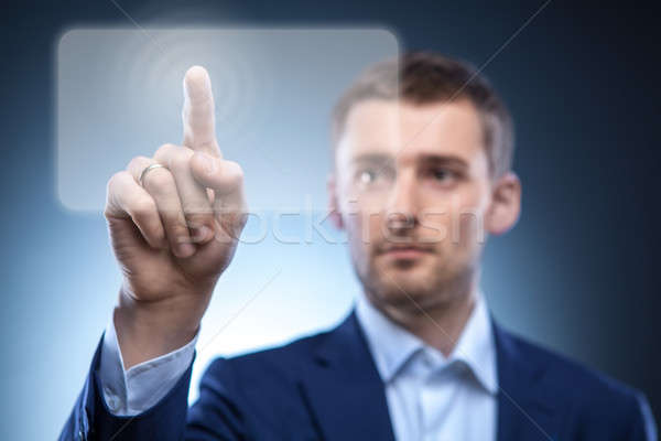 business man pressing touchscreen button Stock photo © artjazz