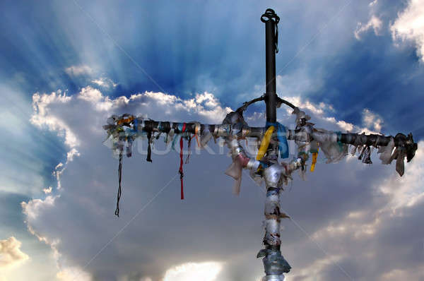 Cross with ribbons against clouds Stock photo © artjazz