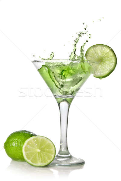 Green alchohol cocktail with splash and green lime isolated on white Stock photo © artjazz