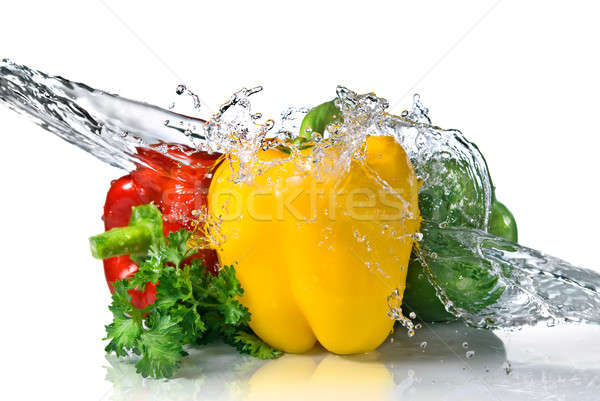 red, yellow, green pepper and parsley with water splash isolated on white Stock photo © artjazz