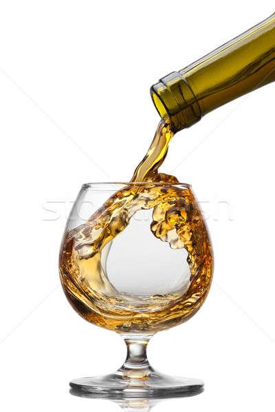 コニャック ガラス スプラッシュ 孤立した 白 ストックフォト © artjazz