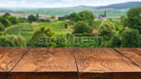 Empty wooden table with vineyard landscape in France Stock photo © artjazz