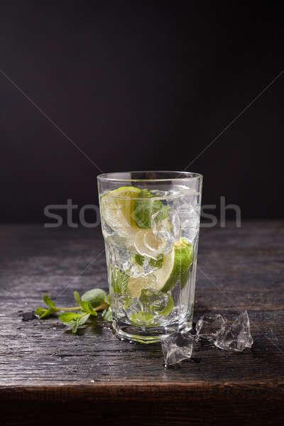 Citrus lemonade lemon cocktail on dark background Stock photo © artjazz