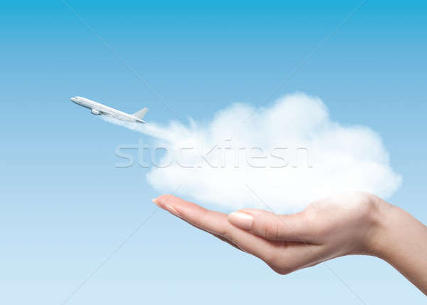 Woman holding cloud with plane taking off Stock photo © artjazz